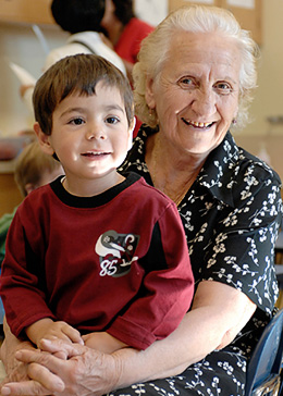 Pre-school child with caregiver engaged in learning