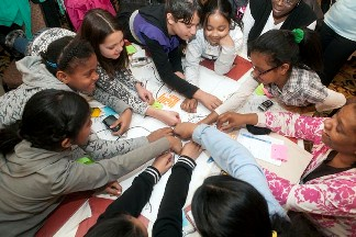 A group of young girls participating during an activity