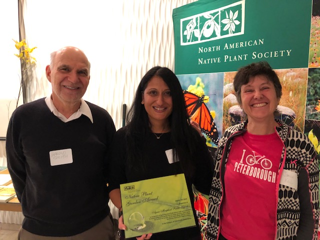Picture of TDSB faculty member Ms. Wadia accepting the Garden Award on behalf of Agnes Macphail school community.