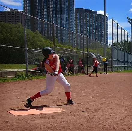A girl is playing Slo-Pitch