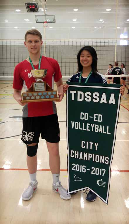 2 volleyball players are smiling