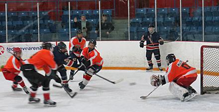 Boys are playing hockey
