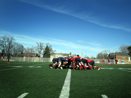 Senior boys from Northern SS and Lawrence Park CI scrum over the ball.