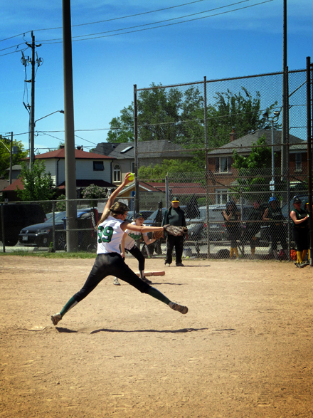 The Leaside pitcher winds up her best arm as she throws towards the Etobicoke CI athlete.