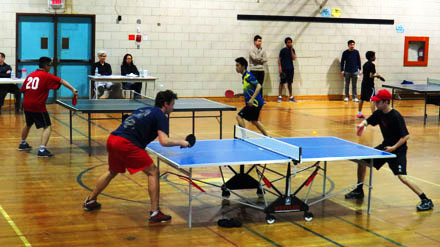 Two games are shown with the boys battling it out over the table top as the ping pong flies through the air.