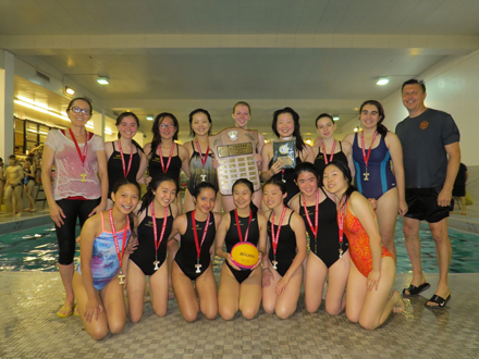 Victoria Park CI Girls' Water Polo team and their coaches pose for their Championship winning picture.