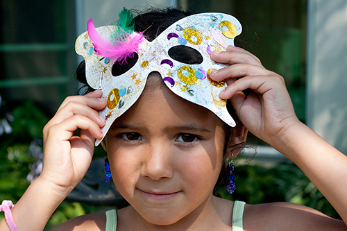 Young girl with a butterfly eye mask