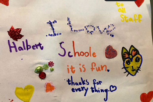 A student from H.A. Halbert Junior Public School shares a note about school being fun.