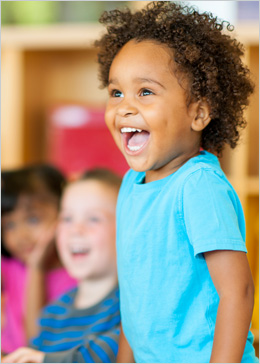 Child laughing in classroom