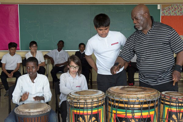 Image of students playing drums