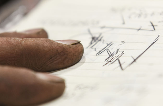 Close up image of fingers examining blueprints
